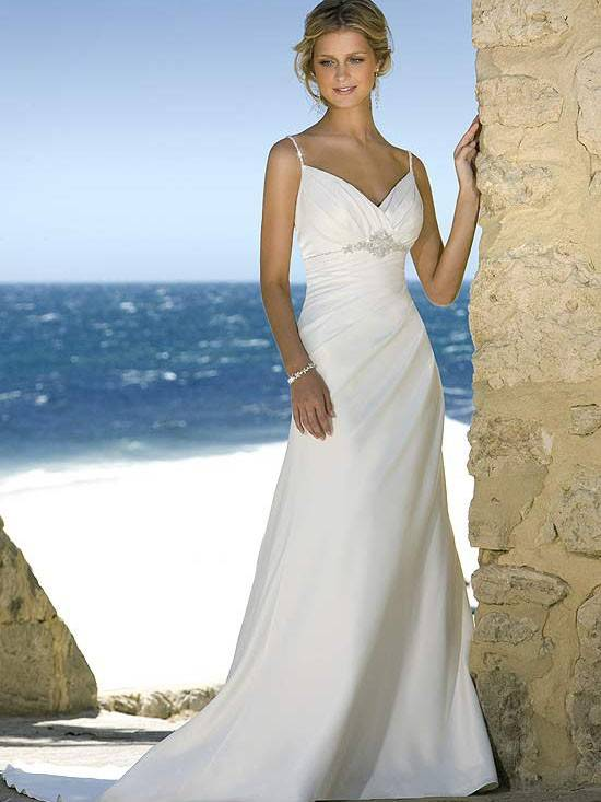 Beach wedding gown features in satin and drapes in a modified silhouette