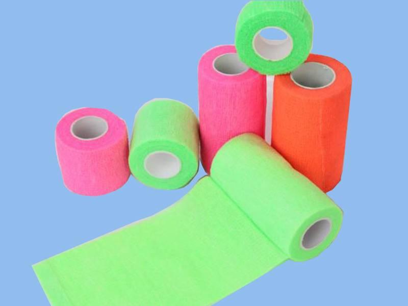 Self-adhesive elastic cohesive bandage