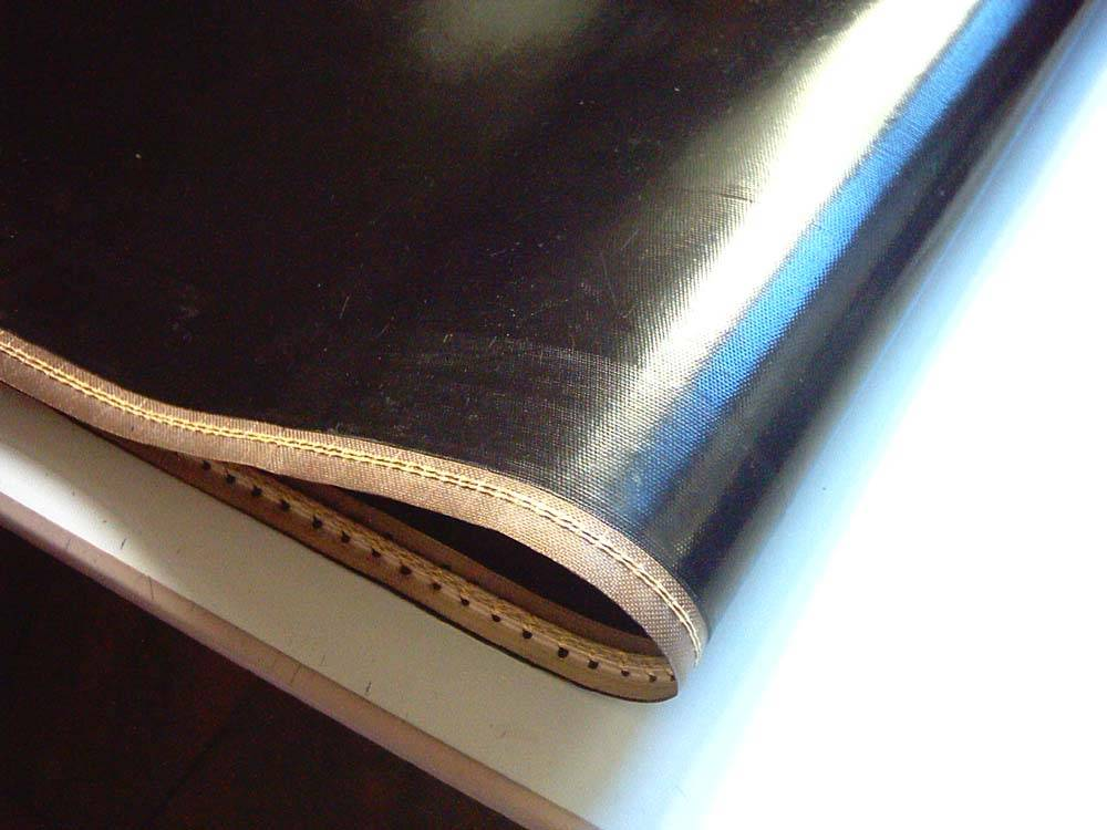 Anti deflection track fusing machine belt