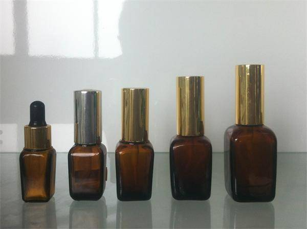 selling cosmetic essential oil glass dropper bottles with lids made in china
