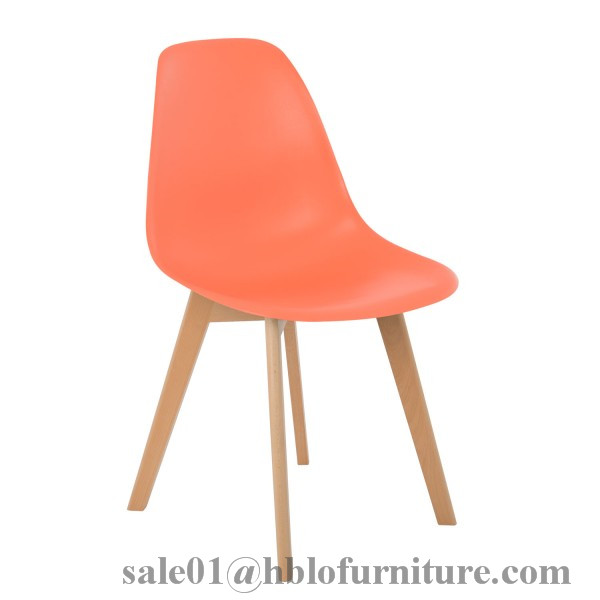 multi-colored eames molded plastic tuilp chair solid wood legs