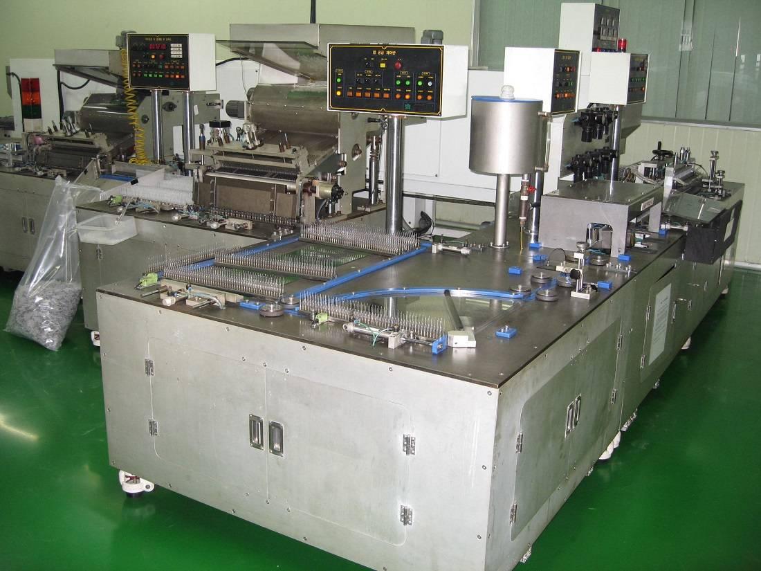 Needle assembly machine