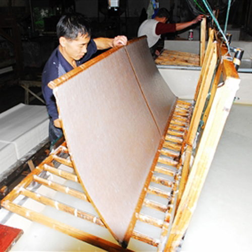 Papermaking cationic retention and drainage aid