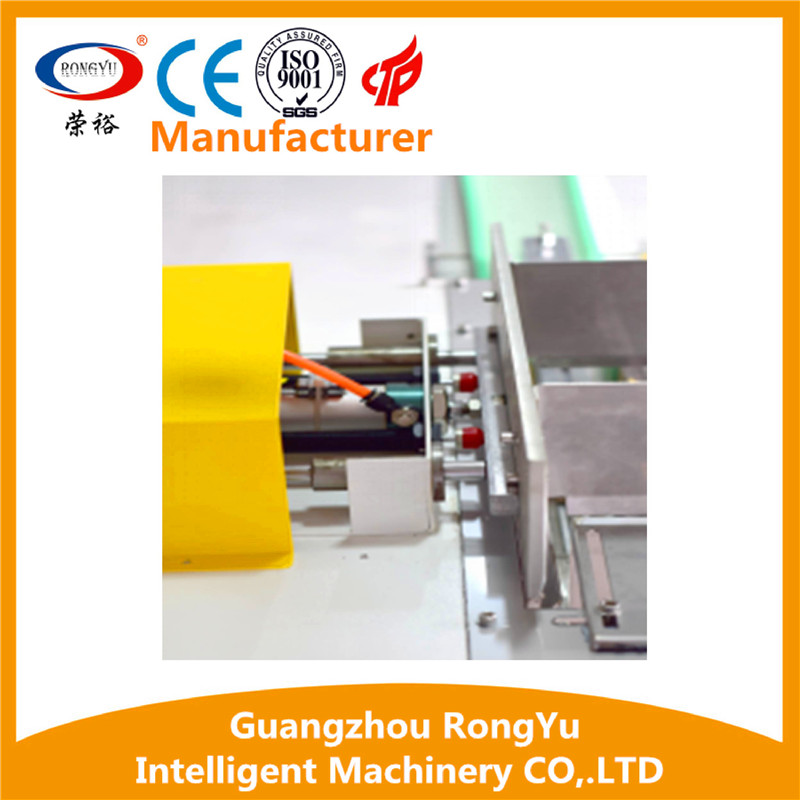Automatic sleeve sealing and shrink wrapping machine for adhesive tapes