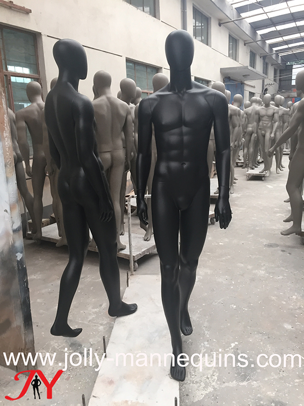 jolly mannequin-sport male mannequin.black matte finish, right legs in front left legs in behind