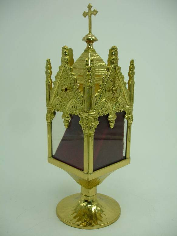 An Ideal Castle Style Bottom Circular Hammer Group in this Brass Reliquary X16
