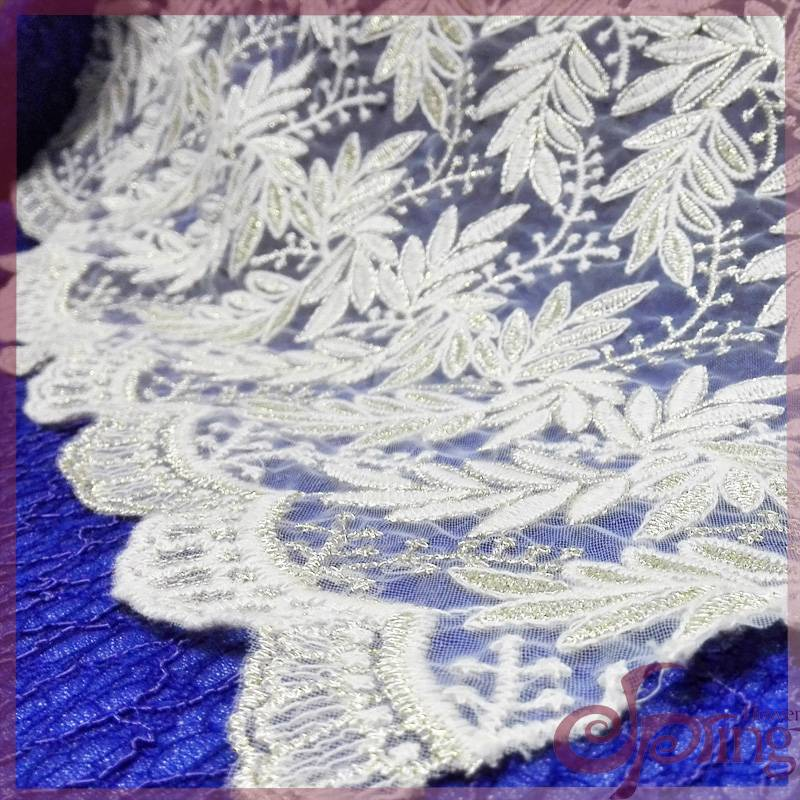 Mesh lace fabric embroided with gold thread