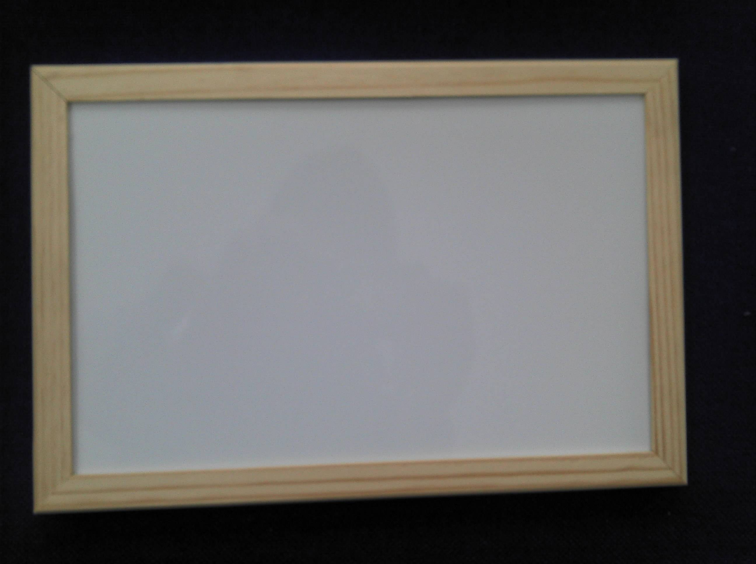 magnetic white board in wooden frame