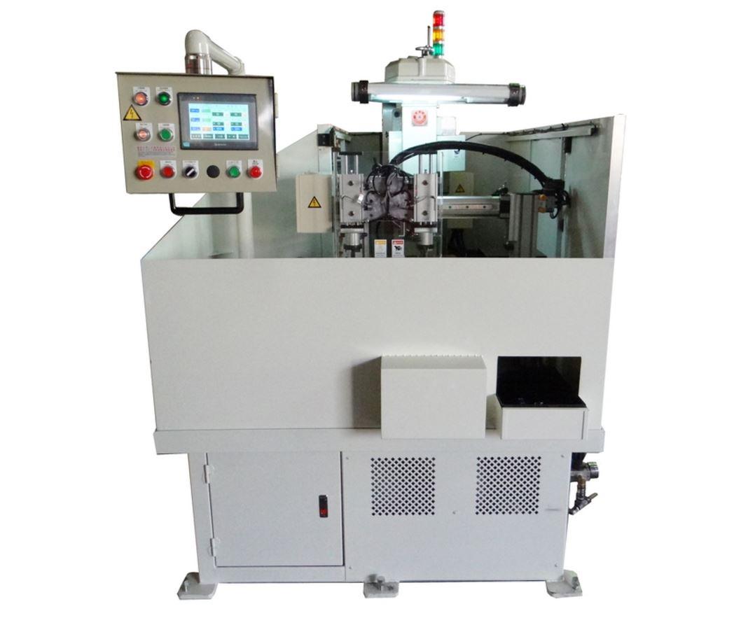 Tapping machine with manipulator auto feeding