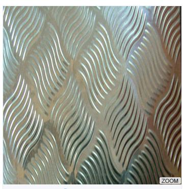 Embossed composite aluminum foil