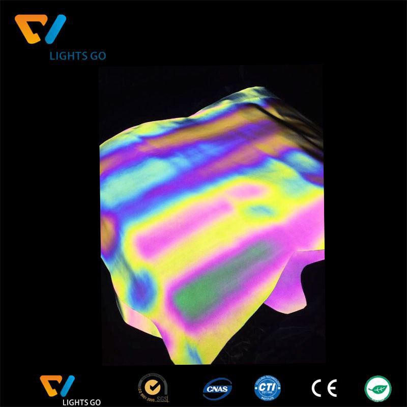 Heat resistant rainbow reflective film for heat transfer on clothing