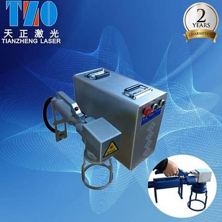Handheld laser marker system