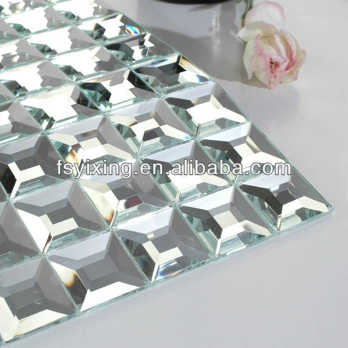 silver color beveled mirror  glass mosaic tiles decorate the wall