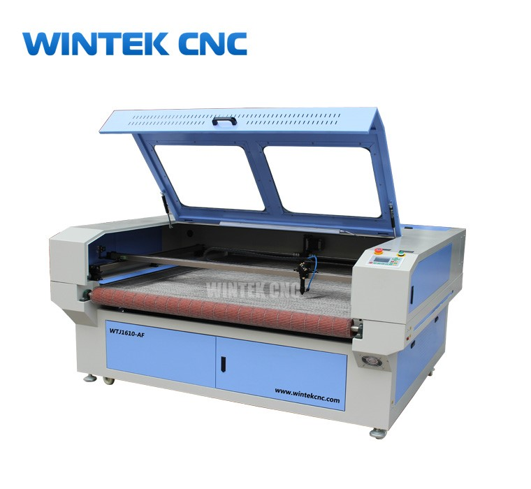 Fabric laser cutting machine with auto feeding device