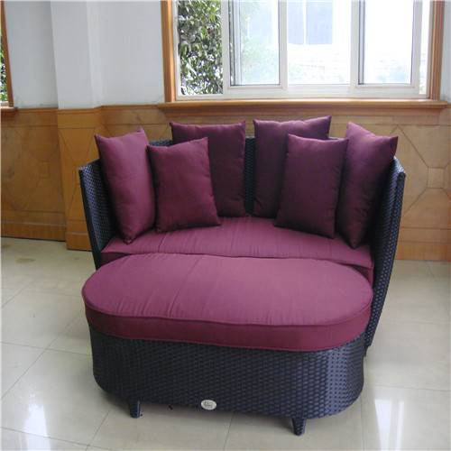 Rattan patio daybed with one stool