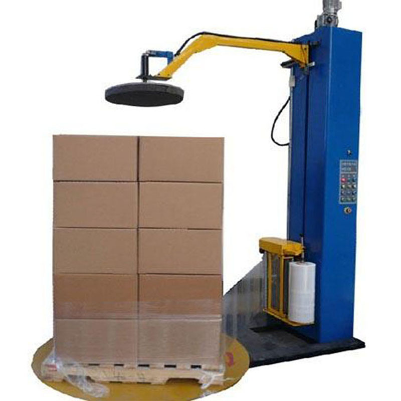 Top platen pallet wrapping machine