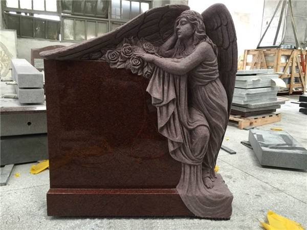 India red granite monument with angel