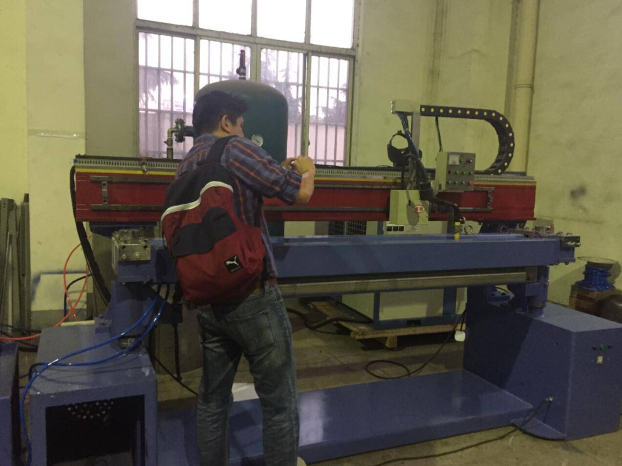 Longitudinal welding machine for galvanised steel/stainless steel