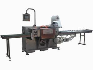 Surgical latex glove packaging machine