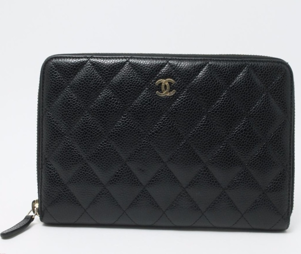 Used authentic designer CHANEL Caviar Skin wallets for bulk sale.