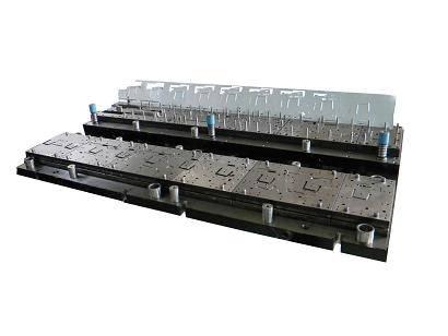 Progressive die for sheet metal parts