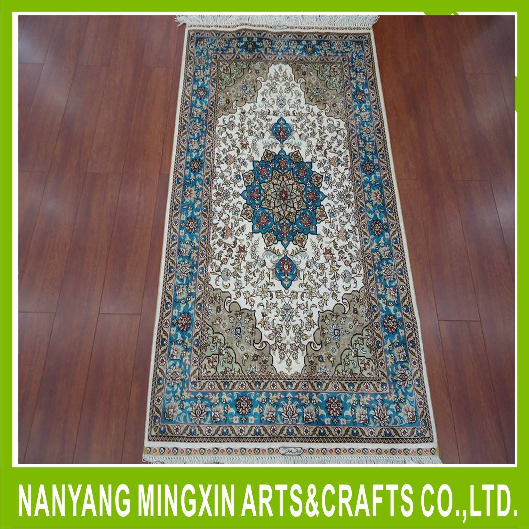 Hand Knotted wool and silk carpets