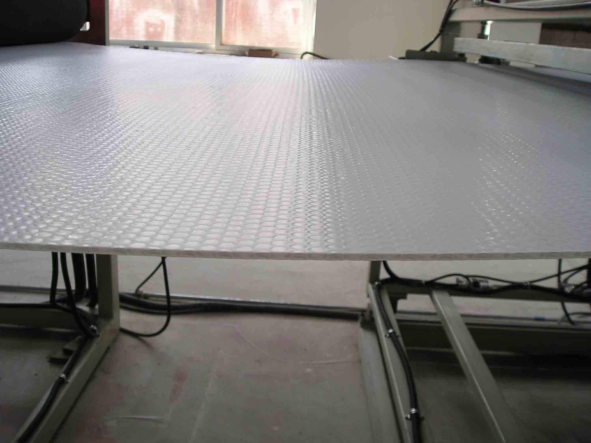 Plastics honeycomb panel machine