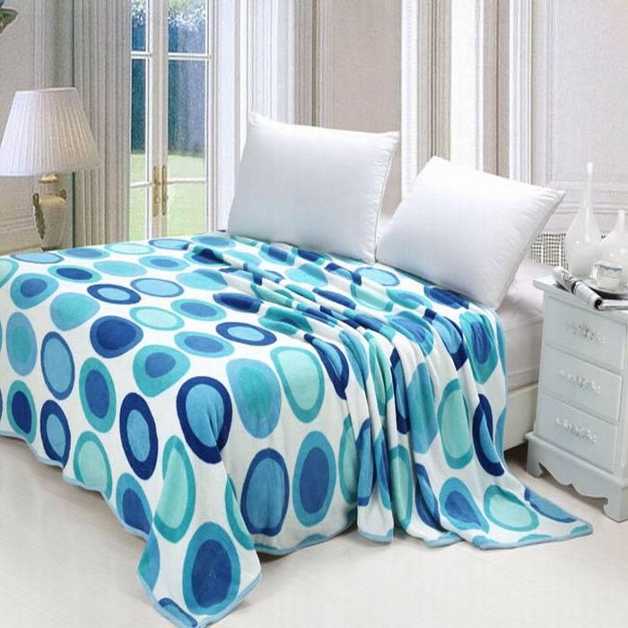 spot printed coral fleece blanket