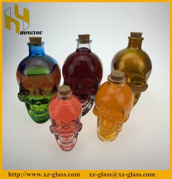 A varity of skull head white wine glass bottle with cork hot sale