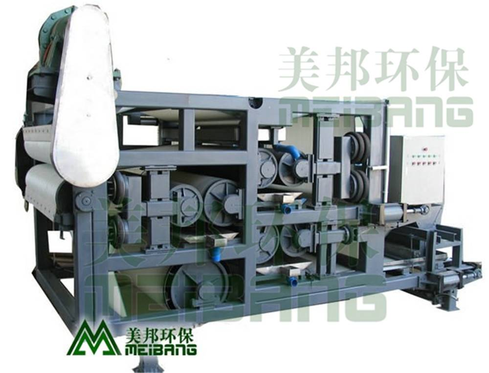 Belt filter sludge dewatering press