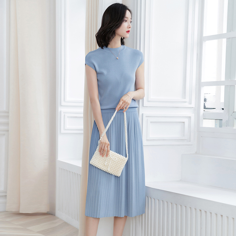 Women Knit Two-pieces suits including Sleeveless Crewneck Knit Tees and Pleated midi Skirts