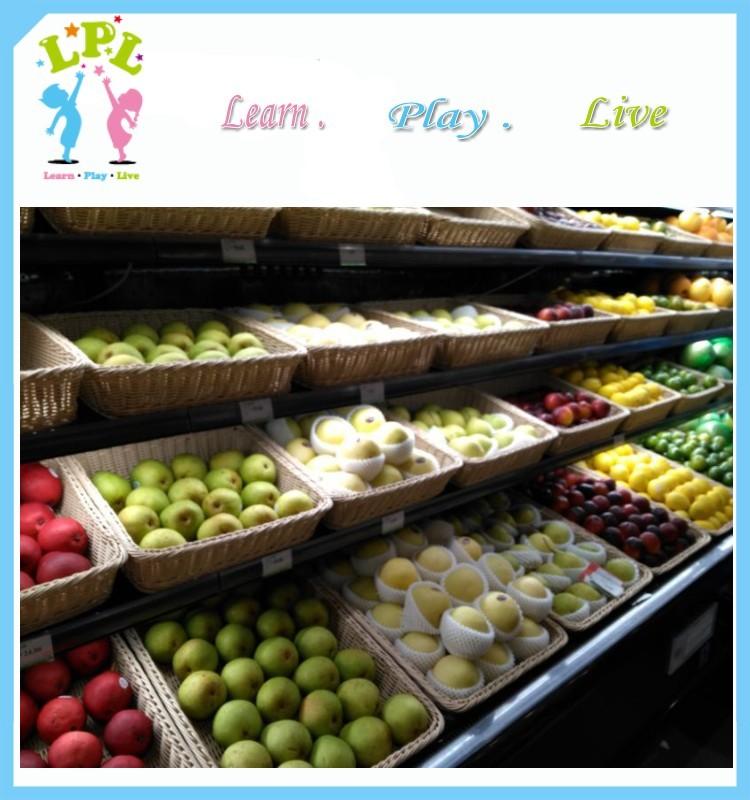 Hot selling artisan 100% woven plastic washable rattan Supermarket storage basket for fruit