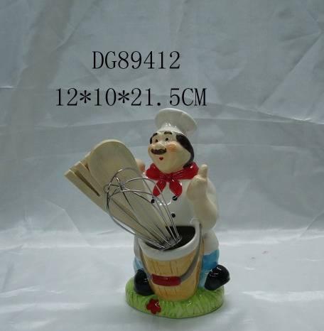 Ceramic chef figurine with kitchen tool
