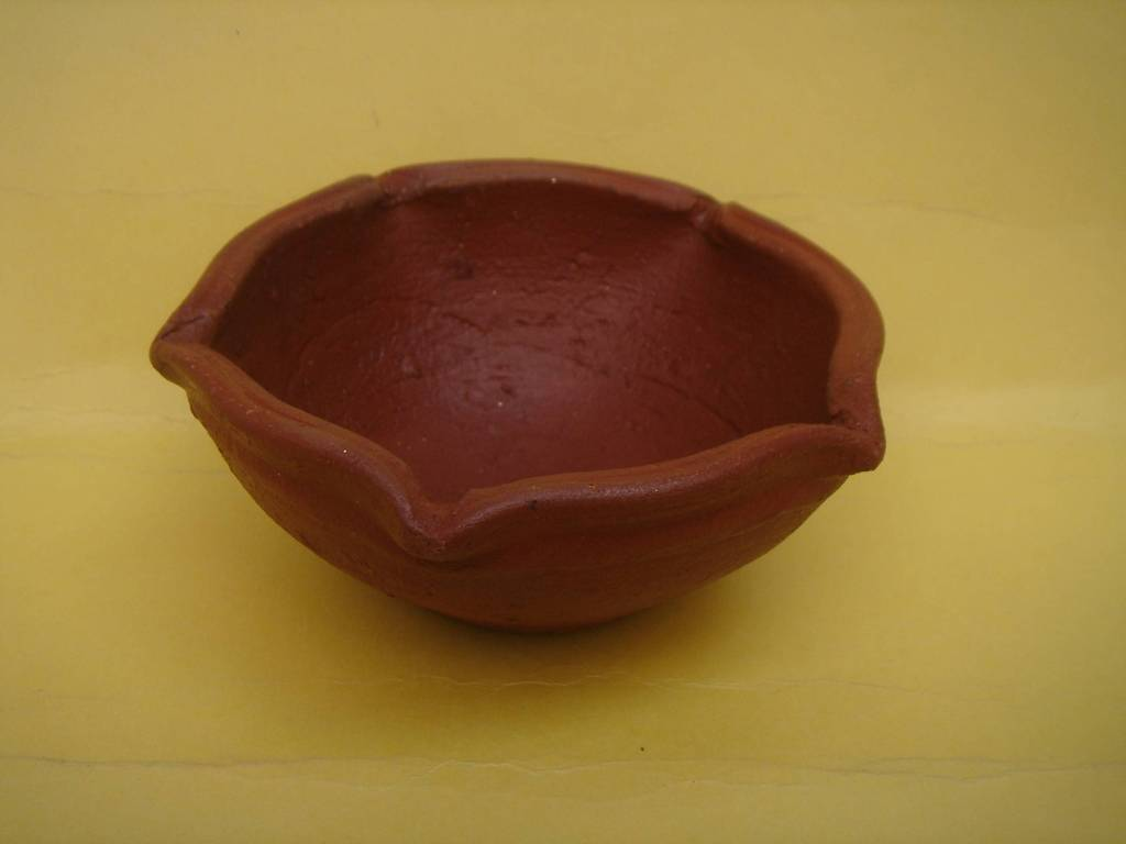Agal vilakku with five face made of fine teracotta clay.
