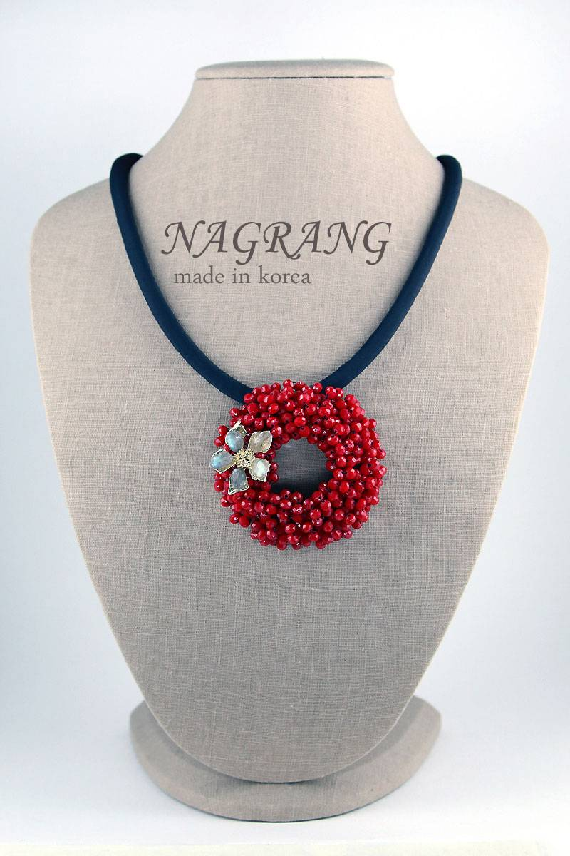 Red crystal brooch with polyester string necklace