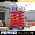 Mobile four wheel hydraulic scissor man lift for sale