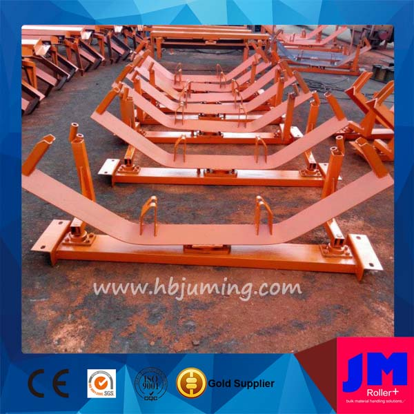 erosion resisting self-aligning conveyor roller frame for belt system