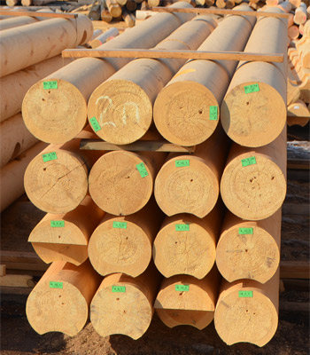 Wooden house construction kit, machine rounded logs