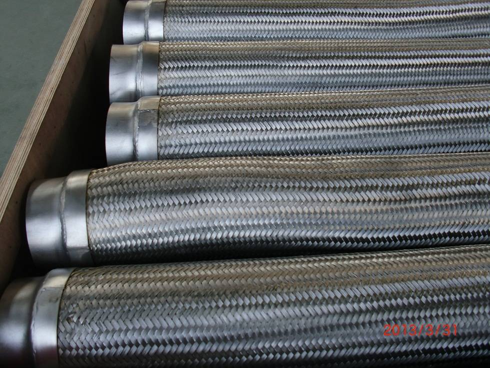 Corrugated flexible metal hose with wire braiding